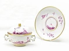 Small Lidded Tureen and Underplate with Landscapes in Purple.   Meissen. Circa 1745/50.     Porcelain, enriched with purple and gold. Tureen with an open panorama of a river landscape, fishers and cottage architecture above two ring lines, finely painted in purple camaieu. The underplate is decorated with wood-cut flowers and insects. Height 11cm/ + 17,5cm.  Crossed swords mark. Gold painter's marks H.7., H.9. and H.12. Tureen with indistinct press number.