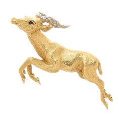 Tiffany & Co. Diamond Gold Gazelle Brooch | From a unique collection of vintage brooches at https://www.1stdibs.com/jewelry/brooches/brooches/