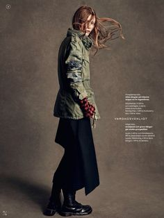 Patched-up military style jacket layered over a checkered plaid flannel from Elle Sweden. // Photo by Andreas Sjodin.