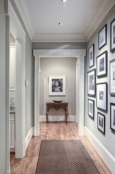 black and white gallery wall -- Want to do this in the hallway upstairs with kids/neices&nephews pictures