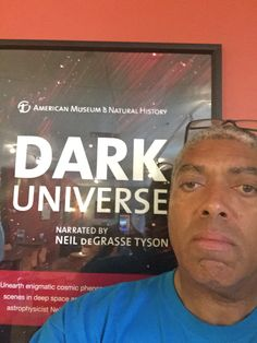 In the Periodic Table Cafe having second breakfast and getting ready for my volunteer shift as a DOME Usher at SMV. Behind me is a movie poster for Dark Universe, which plays at 1400 this evening. We Are Stars plays at 1100 and 1300. National Parks plays at 1200, 1500 and 1600. Michael Lewis 21 June 2016