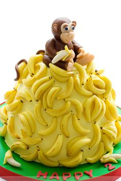 Curious George cake, decorated with marzipan instead of fondant. If I can find a monkey figurine ...