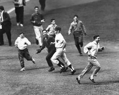 1959 at Yankee Stadium: Mickey Mantle navigates his way, through some fans after a game winning home run.
