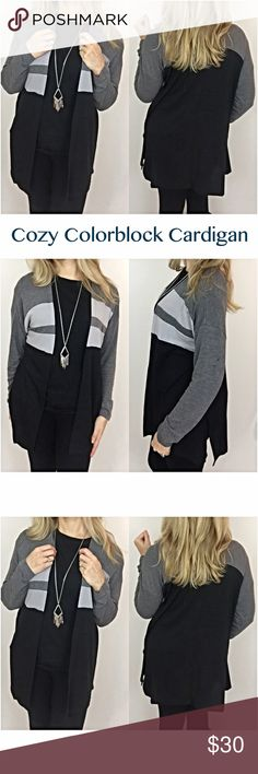 "Cozy Colorblock Cardigan Black & Gray SML Enjoy being cute & cozy in this colorblock open front cardigan in neutral black & gray. Side slits add some flow to this relaxed fit, lightweight sweater made of 65% Polyester/ 35% Rayon. Easy to wear with jeans or leggings. SML  • Small Bust 42"" Length 30"" • Medium Bust 43"" Length 30.5"" • Large Bust 44"" Length 31"" Sweaters Cardigans"