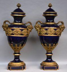 Lot 847: A rare pair of Sèvres porcelain vases with a bleu royale background and marvelous bronze mounts, late 19thC, H 104 cm  € 5.000 - € 7.000