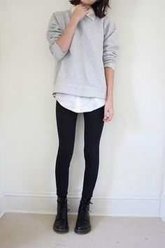 black jeans, black boots, white button down shirt, grey pullover jumper