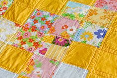 Such cheery colors! Yellow and floral patchwork quilt