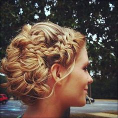 Side crown braid with curly hair pinned up for a pretty bridal updo