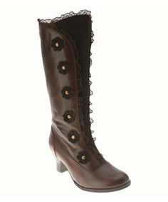 A classically styled cadence begins with these smooth leather boots. Daisy appliqués and a delicate ruffle trim create a boot with feminine appeal.2.25'' heel12'' shaft14'' circumferenceZipper closureLeather upper...