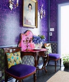 violet upholstery chairs and a printed statement wall