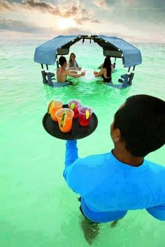 Now this is the way to enjoy happy hour! Service with a smile at The Ritz-Carlton, Grand Cayman