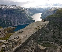 The Norwegian word for this place is Trolltunga which means Troll's Tongue. Description from pinterest.com. I searched for this on bing.com/images