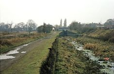 Opened in 1843 the Bentley Canal ran down a flight of 10 locks from the junction with the Wyrley & Essington Canal at Wednesfield for a distance of nearly three and a half miles to its junction with the Anson Branch. The section from the bottom of the six Willenhall Locks to the Anson Branch was closed in the 1960's. This view from April 1984 shows the empty channel looking back towards the junction at Wednesfield. Birmingham Canal, Wille, Industrial Architecture, Canal Boat, Wolverhampton, Rivers, Distance, Empty, Abandoned