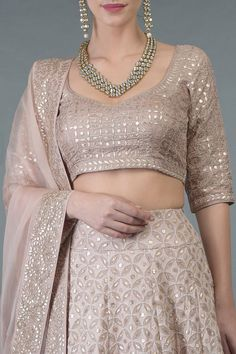 From our Bridal Heritage Collection, this timeless oyster pink outfit presenting a beautiful fusion of heritage thread crafts Chikankari and rose gold gota patti hand embroidey. The lehenga is crafted in pure georgette and adorned with chikankari Indian Fashion Dresses, Indian Designer Outfits, Indian Outfits, Designer Dresses, Pakistani Formal Dresses, Pakistani Suits, Pakistani Bridal, Indian Bridal, Lengha Blouse Designs