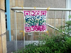 A knitted qr code. I just made my own qr code last week. I am so going to do this.