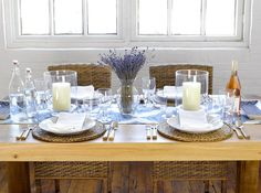 May 2013 Issue - A wooden dining table set with hurricane vases, dried lavender, and a blue-and-white runner