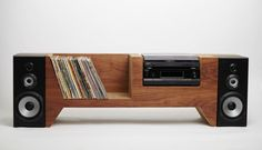 A custom record player console made to hold your record player, audio equipment, speakers, and a collection of records, with a secret compartment hidden behind the right speaker. Constructed of a corrugated cardboard core with walnut face and back panels. Stereo Cabinet, Record Cabinet, Cabinet Furniture, Diy Furniture, Furniture Design, Audio Design, Speaker Design, Record Player Console, Record Table