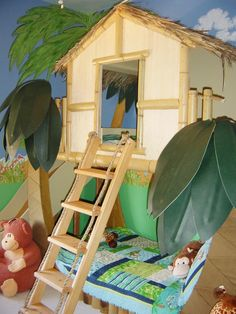 Between adventures, a junior explorer can escape to a treehouse bed in this jungle-themed room.