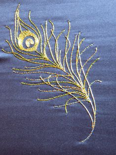 Peacock feather goldwork embroidery
