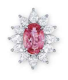 A PADPARADSCHA SAPPHIRE AND DIAMOND RING. Centering upon an oval-shaped padparadscha sapphire weighing 6.78 carats, within a pear-shaped diamond radiating surround, mounted in platinum. Christie's
