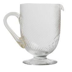 """This exquisite pitcher is decorated on the surface by crossing ridges traditionally called """"riga mena"""". Both base and handle of this elegant piece have a smooth finish."""