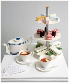 All made out of paper! I bet you could play around and figure out at least the tea sandwiches for some simple decorations -- or commission Benja Harvey to do yours bespoke!