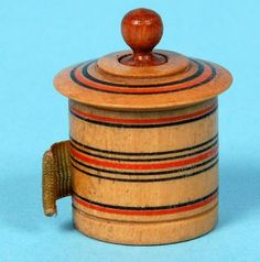 A sweet Tunbridge Ware painted tape measure painted with concentric rings and with original tape marked in nails (England, c. 1820) Offered by Amherst Antiques at The Edenbridge Galleries, Kent. www.edenbridgegalleries.com
