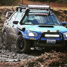 Owner - @fieldsdallas. Tearing up the mud pit !!! West Coast Subaru Show 17  Good times !  #subaru #rally #sti #mudflaps #custom #cargorack #lightbar #rallybar #safarisnorkel #mudpit