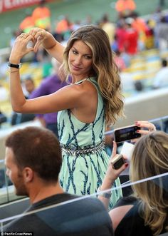 Ready for her close up: Gisele posed for a photo, making a heart shape with her hands
