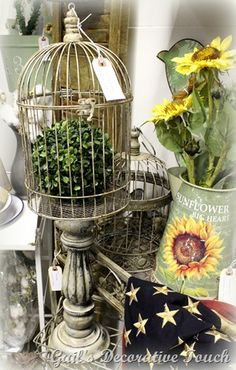 Wood candlestick painted white, distressed with dark wax, birdcage glued to top. So cute!