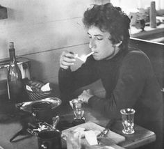 Bob Dylan lights up. S)