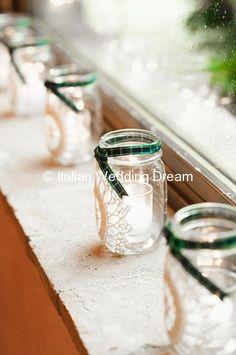 Mason jars with doilies and tartan with candles inside   Italian Wedding Dream