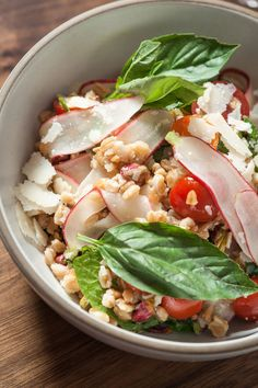 Healthy Farro Salad with cherry tomatoes, shaved radishes, pistachios and Parmigiano cheese. Bookmark now, make later!