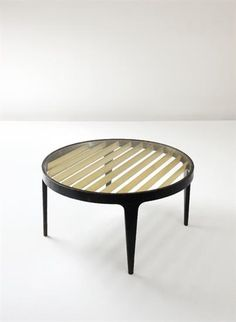 GIO PONTI Coffee table, from the Giulio Cesare ocean liner, Genoa, Italy, 1950  Painted laminated wood, glass, brass. 19 1/4 in. (48.9 cm.) high, 39 1/4 in. (99.7 cm.) diameter