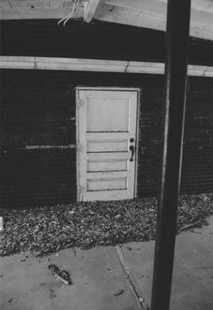 TITLE In One Door, There Is No Other YEAR OF PHOTO 2009  ARTIST Ben Sasson FORMAT 35mm-film LOCATION Savannah, Georgia   Please contact for prints, payment and shipment details.