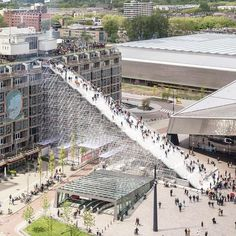 the giant scaffold staircase in #rotterdam by #MVRDV leading from stationsplein, outside the entrance of the central station has opened. at the top, there is an observation deck, a rooftop cinema will open specially for the event, and a rooftop bar.  image by @laurianghinitoiu - read the full @MVRDV article on #designboom! #architecture #stairs