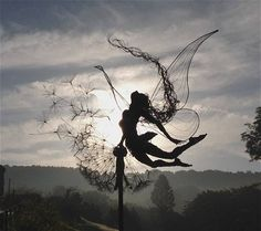 OMG so amazing!!  Several wire fairy sculptures!  Sculpture by Robin Wight. Credit: Fantasywire