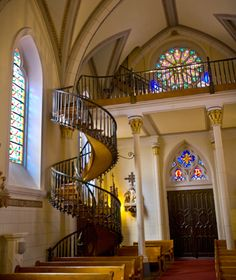 Loretto Chapel Staircase, Santa Fe, NM, USA -- Blue Rose Photography, Travel & Leisure magazine online.  Entirely self-supporting, no central column, and wooden pegs rather than nails.  Built by an unknown carpenter who built it, then disappeared without pay.