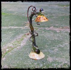 A lovely lamp made from shells, it looks as if it is lit. Sold by pandorajane  on Esty