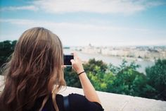 Girl photographing city panorama by Kasia Górska on @creativemarket