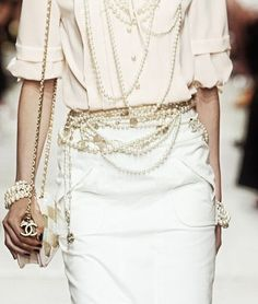 Chanel...Love the belt of pearls.