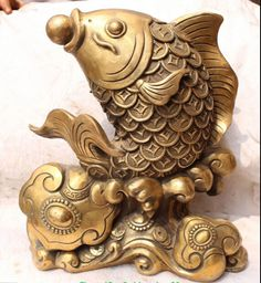 Details about Chinese Bronze Wealth Money Jumper Gold Fish Goldfish Animal Ruyi Sculpture _ - AliExpress Mobile Asian Sculptures, Fish Sculpture, Silver Pooja Items, Lucky Plant, White Wedding Decorations, Pearl Steven, Architectural Sculpture, Bronze, Or Antique