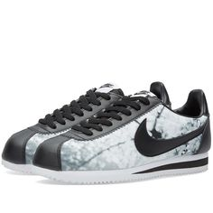 This updated take on Nike's classic Cortez silhouette elevates the original with the additional of a seasonal blossom print upper. Built with a low profile for a comfortable fit, the model is styled with leather overlays, EVA midsole wedge to ensure lightweight cushioning and a rubber outsole.  Printed Synthetic Upper Seasonal Monochrome Print Leather Overlays EVA Midsole Wedge Rubber Outsole Traditional Lacing Unit Style Code: 816284-001