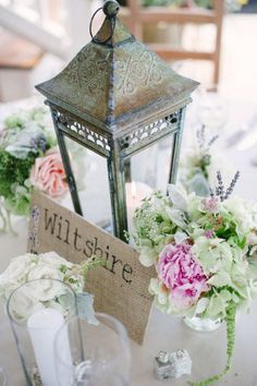 Burlap covered boards with names or phrases stamped on them for table decor