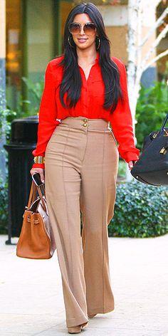 Kim Kardashian curvy style, clothes, high waisted slacks, pants, beige, red blouse, top.