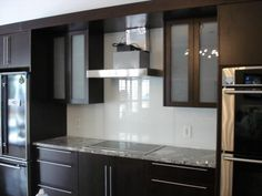 black-cabinet-white-countertop-marble-metal-backsplash-tile love