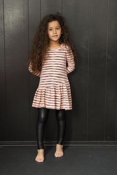 Rough stripe printed dress with Asymmetrical ruffled hem. Perfect for twirling. Preshrunk. Made in the beautiful USA.