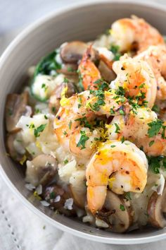 Garlic Shrimp Mushroom Risotto with Spinach - An elegant one bowl meal! Creamy arborio rice is mixed with vegetables and topped with succulent shrimp. | jessicagavin.com