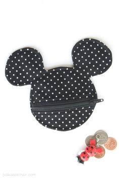 This Mickey Mouse inspired Earbud Pouch Sewing Pattern would be fun to make to tote with you on your next Disney Vacation! It's simple to sew and can be used to hold earbuds, coins or other goodies! I