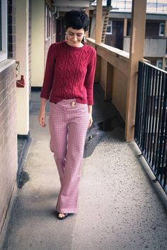 Violaine Bernard - red three-quarter sleeve cable knit sweater half-tucked into plaid pants ( FLAIR fashion & home )